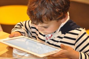 child reading from an iPad