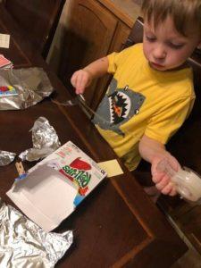 child enjoying crafts