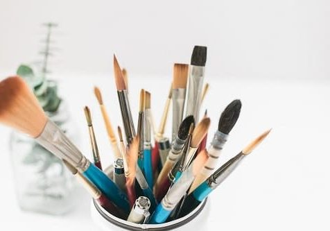 brushes in a tin
