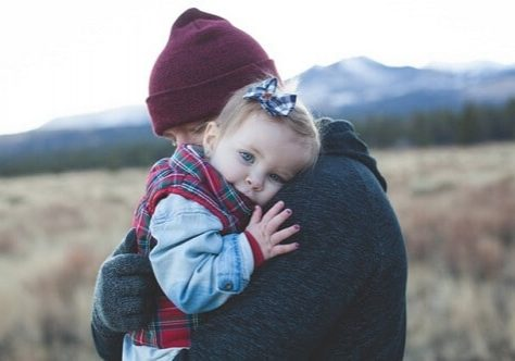 Father holding toddler