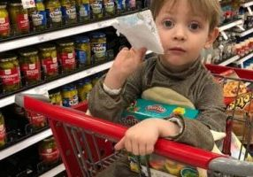 child in trolley while shopping